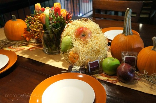 Thanksgiving table setting with flowers and pumpkins
