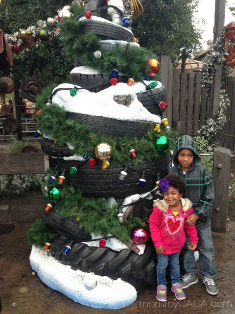 Kids in front of a tire Christmas Tree, Cars Land, Disney California Adventure