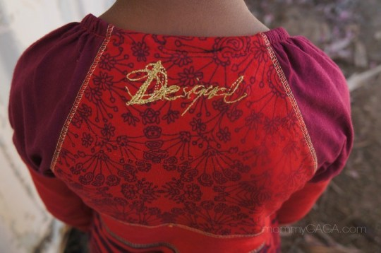 Desigual brand logo on girls dress