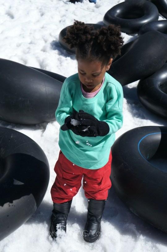 Girl making a snow ball in Big Bear, CA