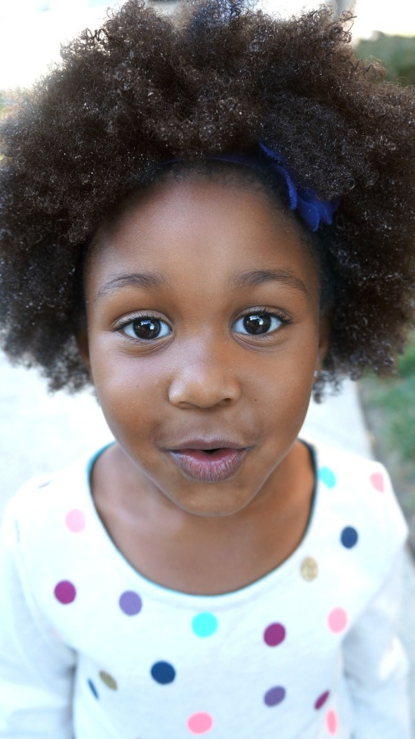 Little mixed girl with natural hair