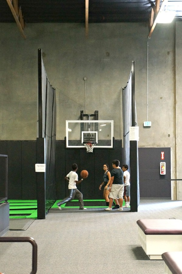 Trampoline basketball court at Jump Around Now