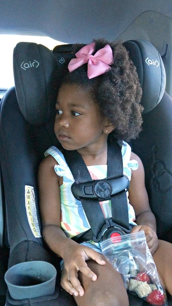 Girl in Maxi Cosi toddler seat