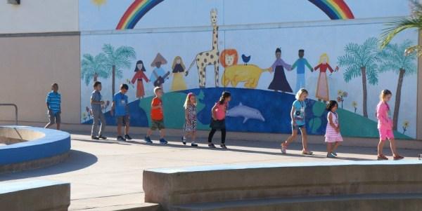 kids walking in a line