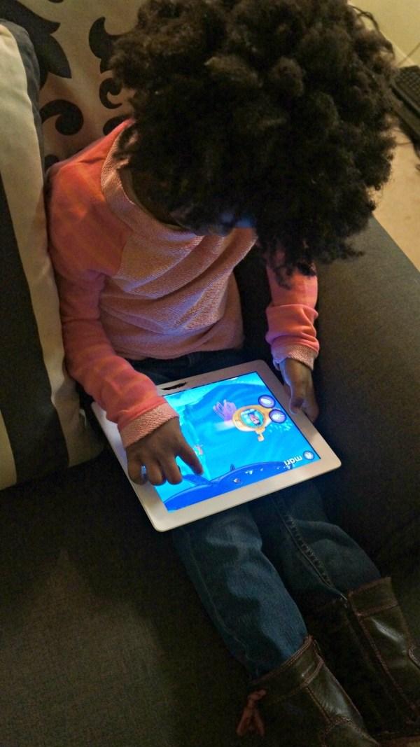 Girl playing Captain McFinn Swim & Play Preschool learning app