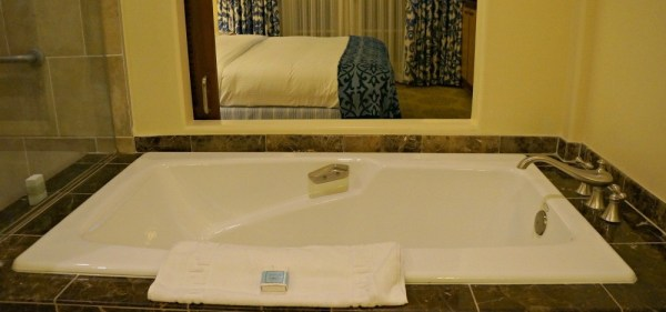 Huge bath tub, looks into the bedroom, Rooms and Suites at Omni La Costa Resort
