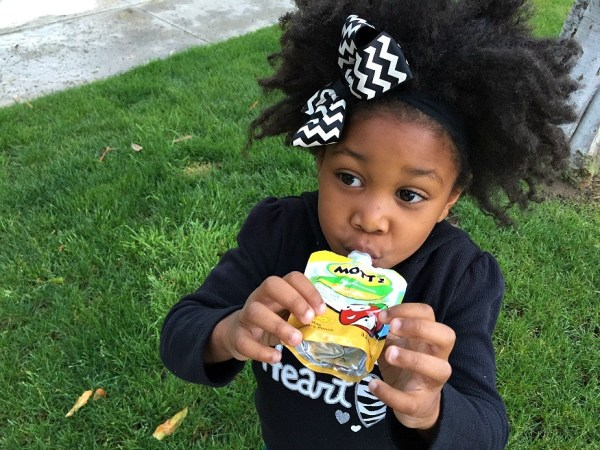 Little girl having Mott's® applesauce snack