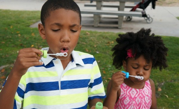 Kids trying to blow bubbles