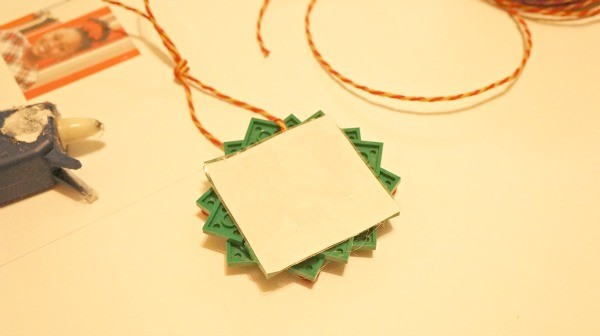 How to make a LEGO wreath photo ornament, glue the photo to the back of the wreath