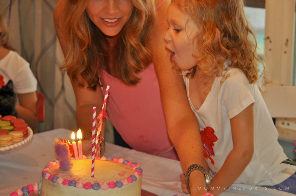 Emy Blowing out Candles