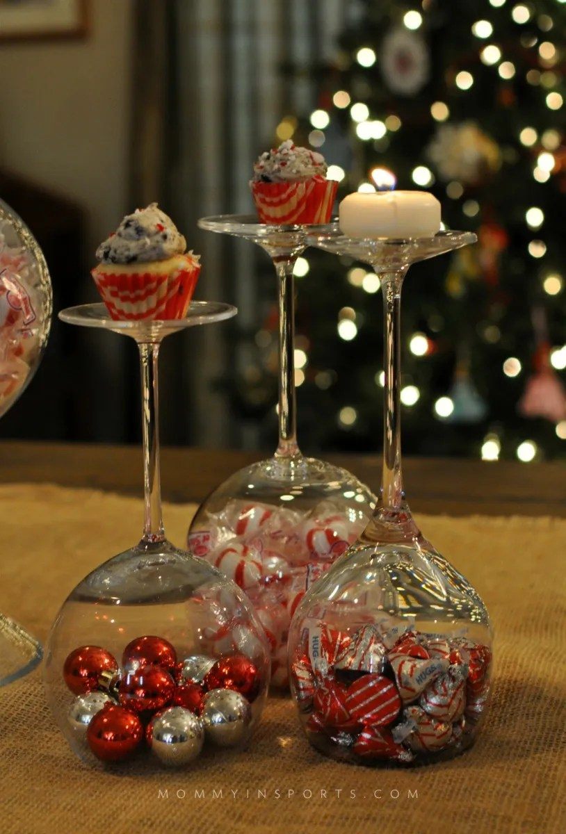 Don't buy new Christmas decorations! Use your wine glasses as an elegant and simple DIY holiday centerpiece!