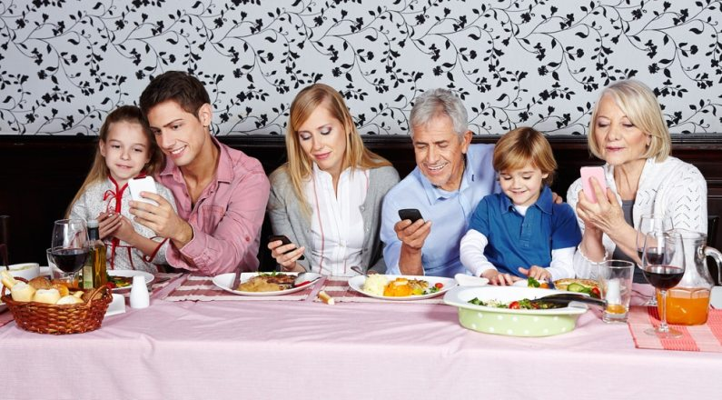 Image result for people on phones at dinner