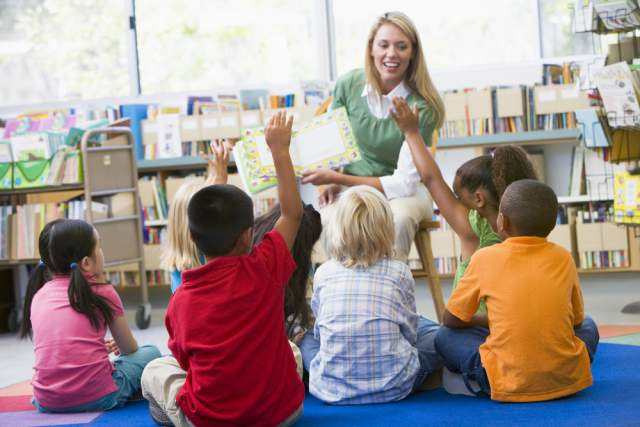 Image result for teacher with kids around her