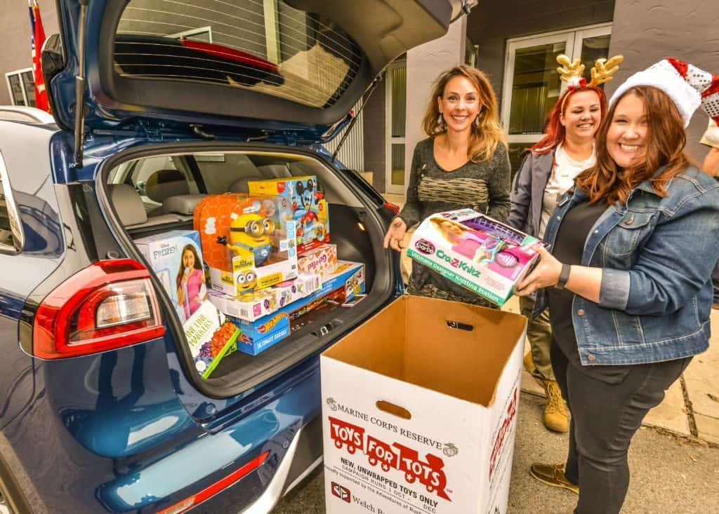 Kia donated lots of toys to Toys For Tots San Antonio. We delivered them in the Kia Niro Hybrid.