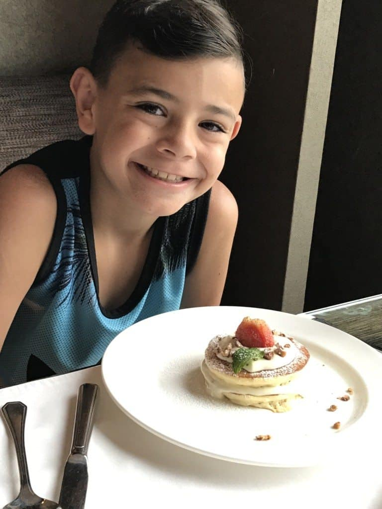 Jonah enjoying his pancakes at Shangri-la Chiang Mai Horizon Club lounge