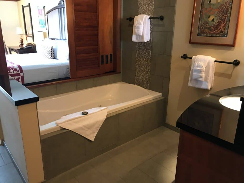 Separate bathtub area and sink in the Aulani suites
