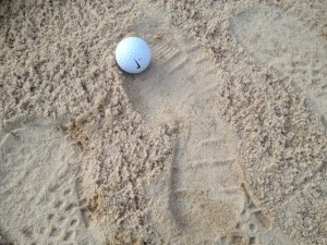 Footprints in the bunker. golf rules