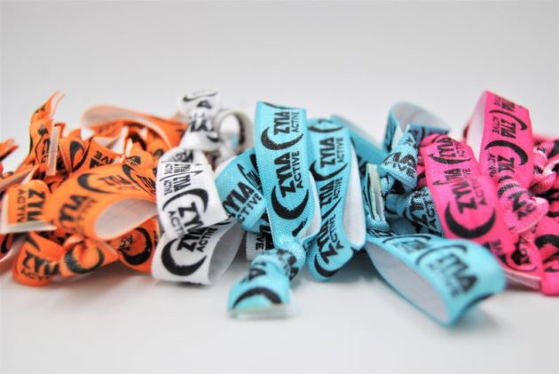 Photo of Zyia branded hari ties in orange, white, blue and pink colors with white background.