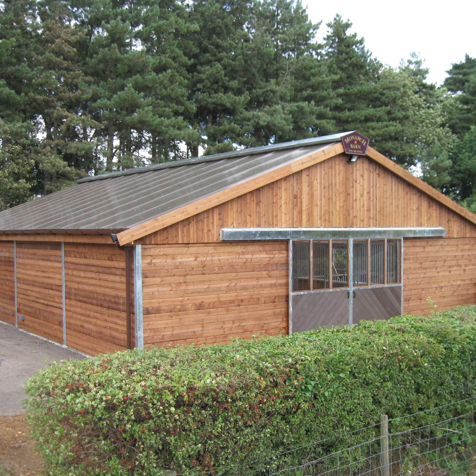 Steel framed Monarch Barn with polycarbonate roof and sliding barn doors