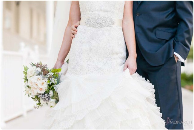 Lace-wedding-dress-white-green-bridal-bouquet-navy-groom-suit