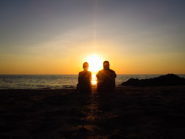 Tiago and Fernanda watching the sunset