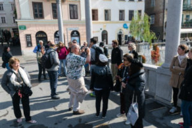 group taking pictures in Ljubljana during the free walking tour
