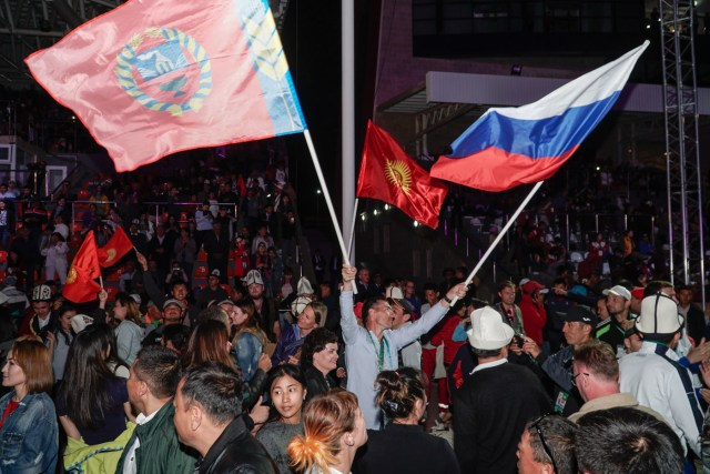 crowd waving flags at the World Nomad Games