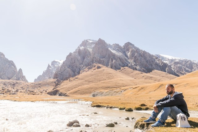 Tiago standing by a stream in Kyrgyzstan on our way to Kel Suu Lake
