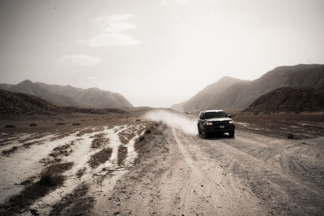 Driving through dirty roads in Kyrgyzstan alone in the mountains