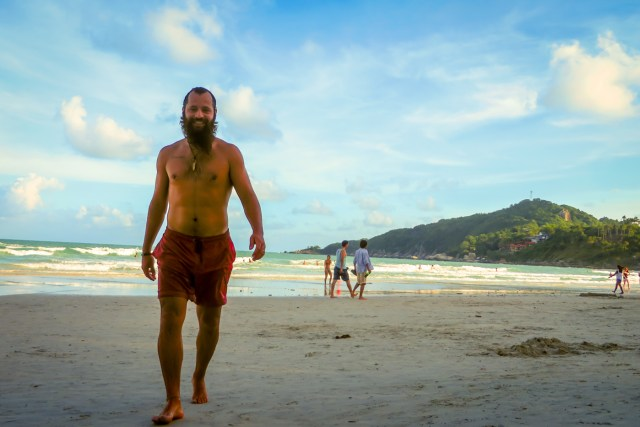 Tiago walking in the beach in Koh Phangan during the Full Moon Party 2019