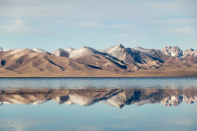 Mountains in Kyrgyzstan reflected in the lake in the mirror effect