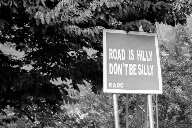 Sign saying Road is hilly, don't be silly