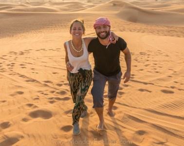 Tiago and Fernanda walking in the desert of Dubai