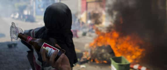 A protester throws a Molotov cocktail at police during a demonstration in Sao Paulo