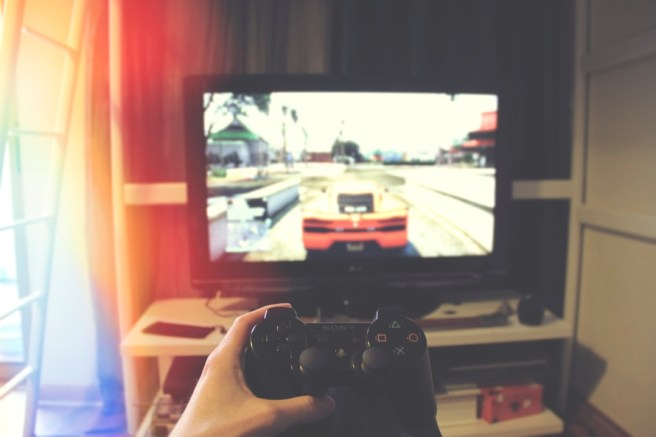 Playing PlayStation gaming console