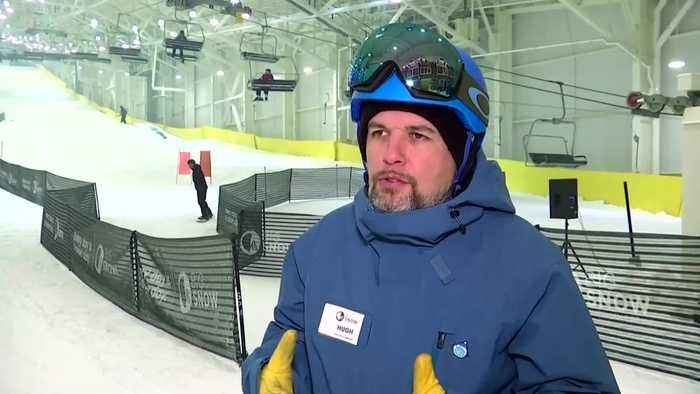 Snowboarders and skiers 'shred pow' in a NJ mall, the first indoor ski slope in North America