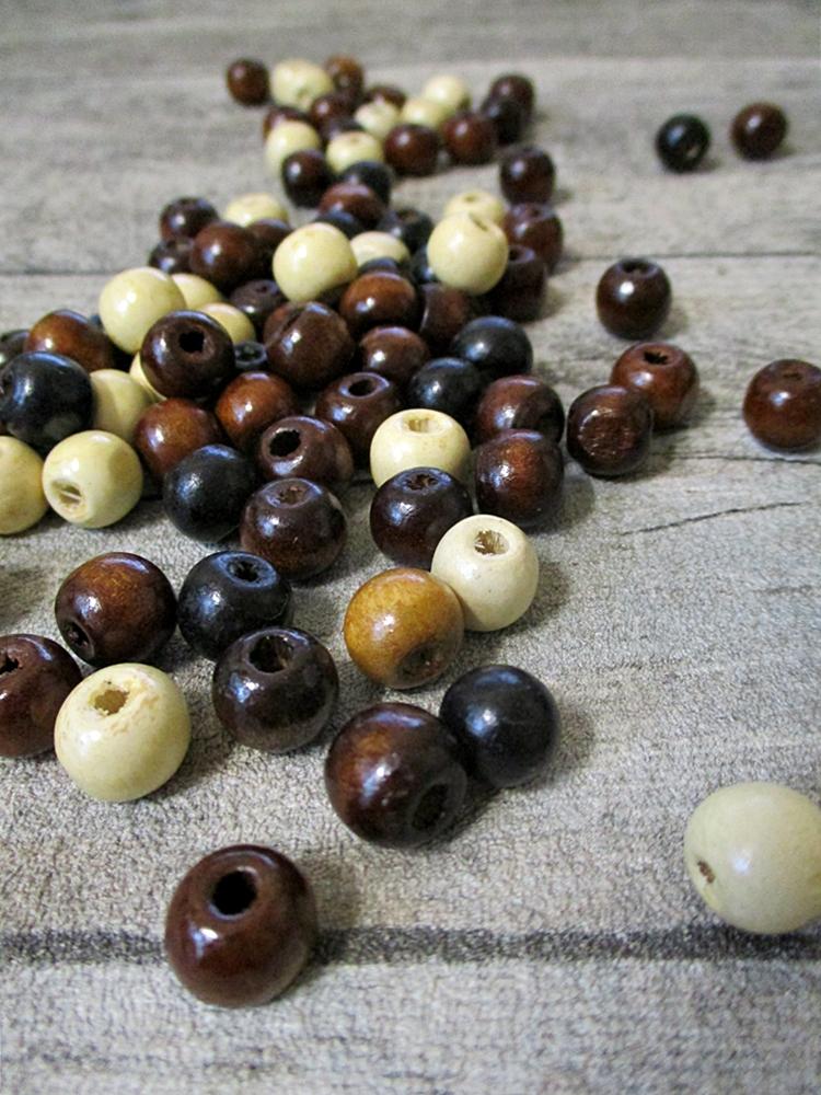 Holzperlen Holzkugeln Großloch natur braun schwarz 9mm Fädelloch 3mm - MONDSPINNE