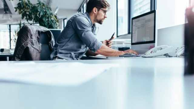 Man Focused Working Computer Office