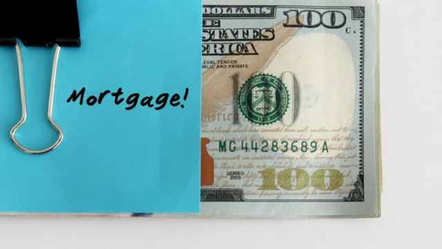 Blue Paper Note Clipping On Cash Mortgage