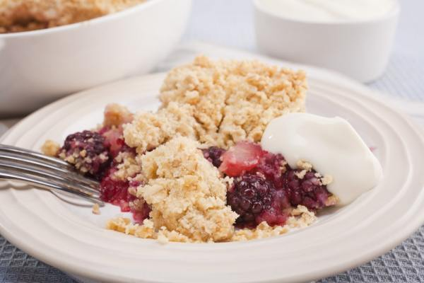 Blackberry and apple crumble on a plate