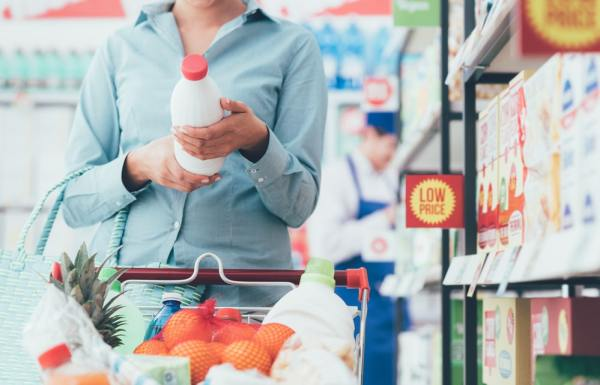 Woman looking at supermarket offers