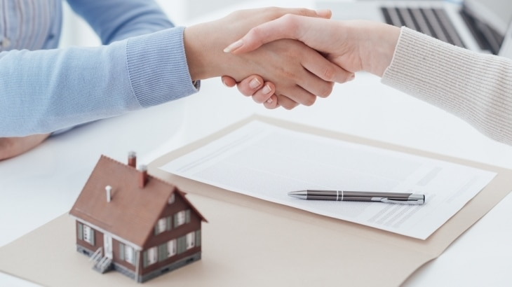Mortgage agreement hand shake