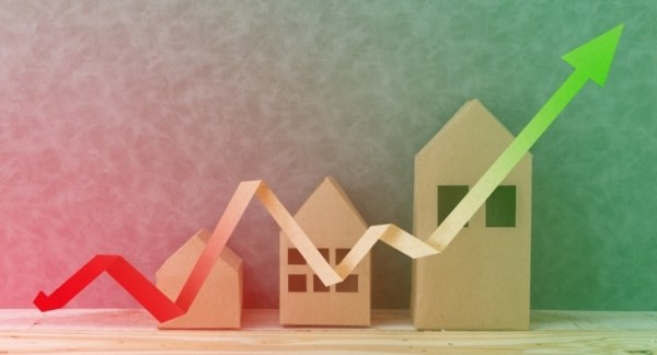 Model houses with upward trend arrow graphic