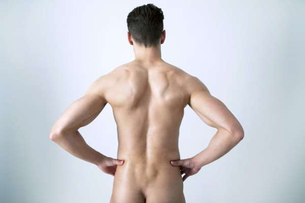 Male life model from behind