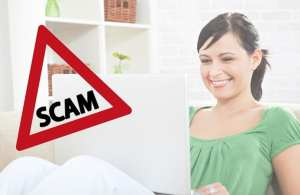 woman using a laptop overlayed by warning triangle with scam written in