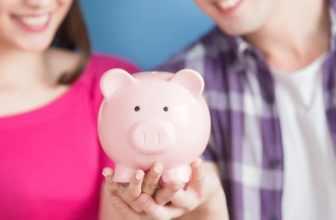 Couple holding piggy bank
