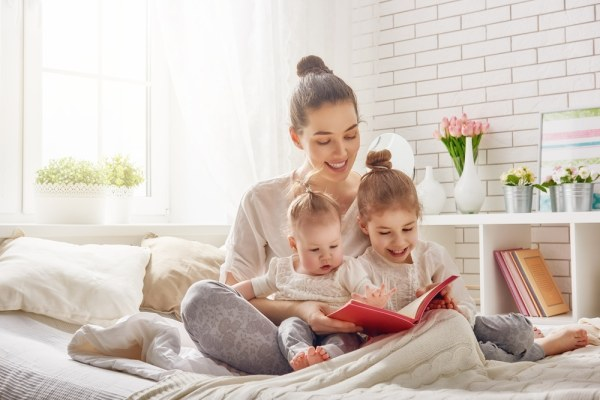 Young female babysitter reading story