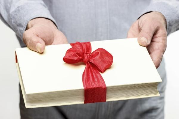 Man giving a book as a gift