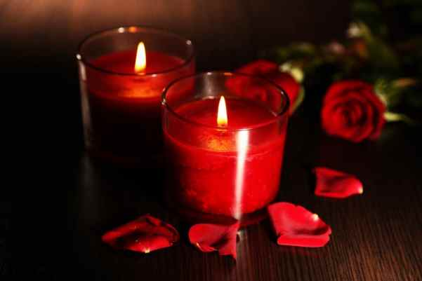 Red rose petals and candles