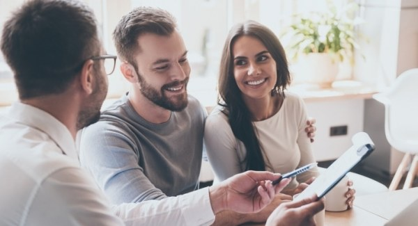 Mortgage adviser talking to young couple